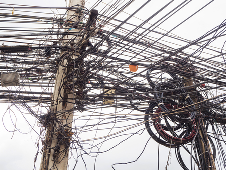 Chaos of cables and wires on electric pole in Chiang Mai,Thailand.