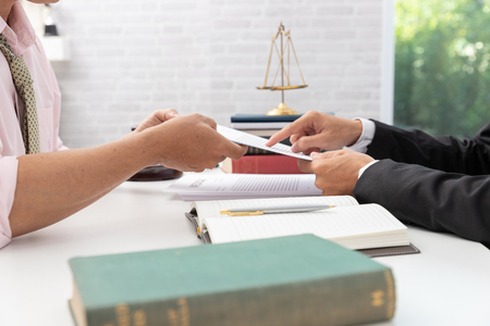 Photo pour Concepts of law, Lawyer and businessman working and discussing business contract papers in office. - image libre de droit