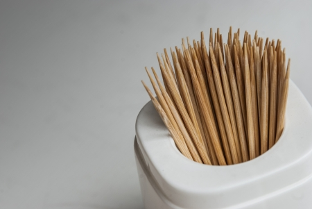 the set of toothpick in the white container