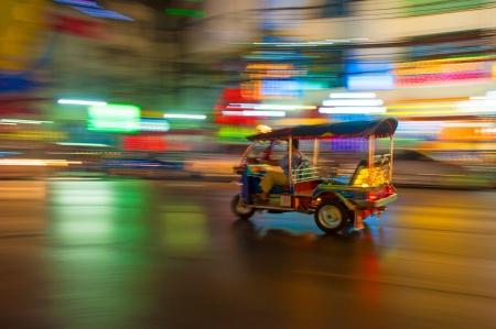 Tuk-tuk in motion blur, Bangkok, Thailand