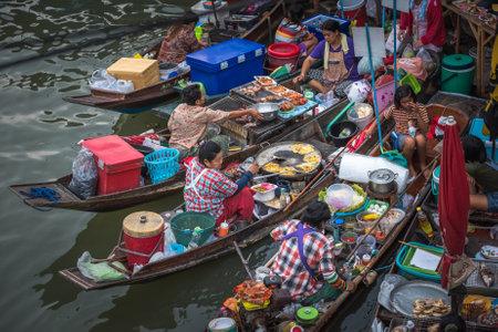 AMPHAWA, THAILAND - January, 24, 2016: Food stalls at Amphawa floating market, Thailand