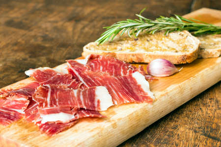 Spanish ham with toasts,rosemay,garlic and olive oil