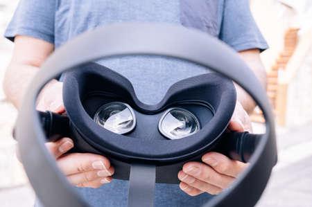 Photo pour Hands holding virtual reality goggles.Futuristic technology concept - image libre de droit