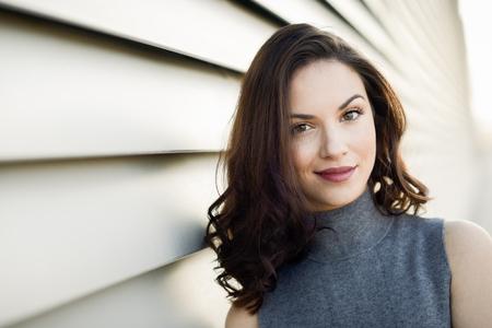 Foto de Beautiful young woman, model of fashion, smiling in urban background - Imagen libre de derechos