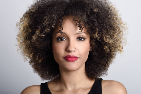 Photo pour Young black woman with afro hairstyle on white background. Girl with african hairstyle. Studio shot. - image libre de droit