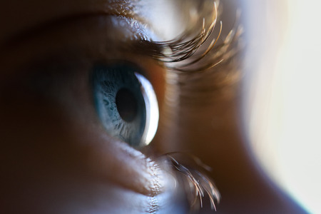 Photo for Close-up of beautiful little girl blue eye. Macro photograph. - Royalty Free Image