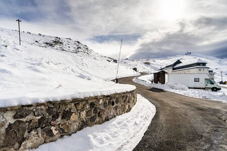Road in ski resort of Sierra Nevada in winter, full of snow.