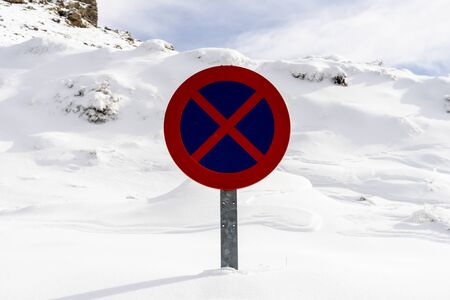 Snowed road sign no parking in Sierra Nevada