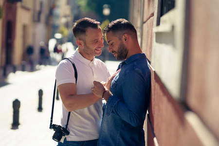 Photo for Gay couple in a romantic moment outdoors - Royalty Free Image