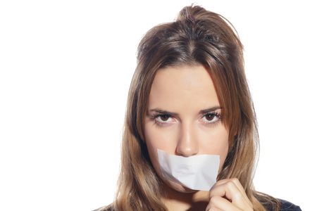 Photo pour Blonde woman silenced with tape, removing it and finally free. Isolated, over a white background. - image libre de droit