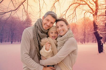Foto de family outdoors in winter landscape - Imagen libre de derechos
