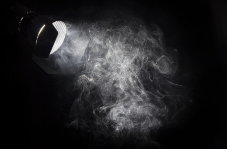 Photo pour Vintage theater white light beam from projector on black background, illuminating smoke.Barn doors and grid used for light directing. - image libre de droit