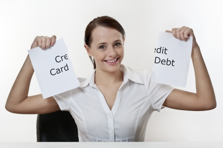 woman sitting at a desk with no credit card debt problems