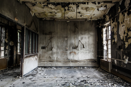 Photo for inside view of a deserted run down building after a fire - Royalty Free Image