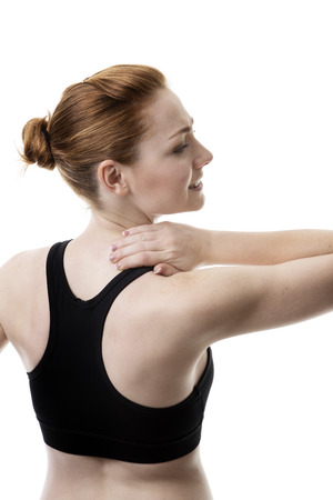 woman with her hand to her neck in pain