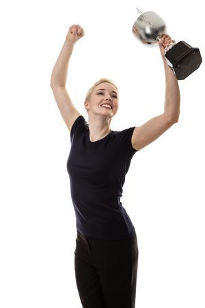Photo pour standing happy business woman holding a large trophy - image libre de droit