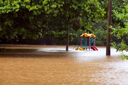 Childrens playground under water after heavy rain and flooding in Queensland Australia