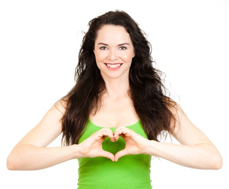 Beautiful young woman making a love heart with hands  Isolated over white