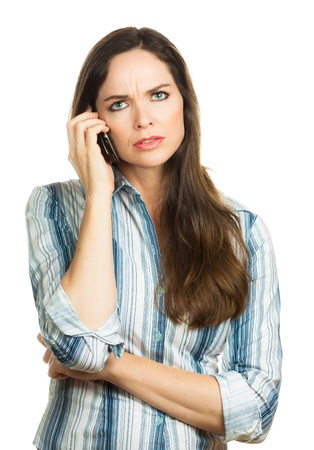 An annoyed and very disappointed business woman on the phone  Isolated over white