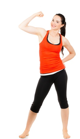 Photo for A fit beautiful sporty young woman flexing her muscles  Isolated on white  - Royalty Free Image