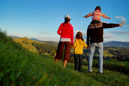 Photo pour Family of four on their vacation in mountains - image libre de droit