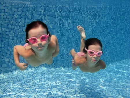 Two underwater kids in swimming pool