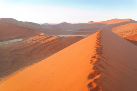 Beautiful sunrise dunes, lake and nature of Namib desert, Sossusvlei, Namibia, South Africa