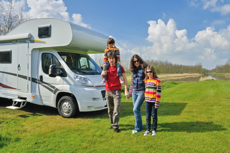 Photo pour Family vacation, RV travel with kids, happy parents with children on holiday trip in motorhome, camper exterior - image libre de droit