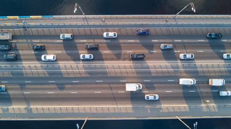 Foto de Aerial top view of bridge road automobile traffic of many cars, transportation concept - Imagen libre de derechos