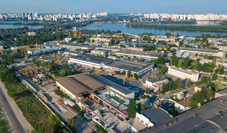 Photo pour Aerial top view of industrial park zone from above, factory chimneys and warehouses, industry district in Kiev (Kyiv), Ukraine - image libre de droit