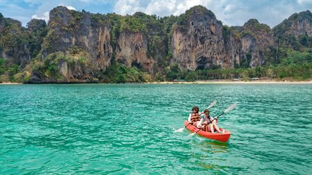 Photo for Family kayaking, mother and daughter paddling in kayak on tropical sea canoe tour near islands, having fun, active vacation with children in Thailand, Krabi - Royalty Free Image