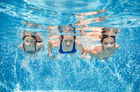 Photo pour Family swims in pool under water, happy active mother and children have fun, fitness and sport with kids on summer vacation - image libre de droit