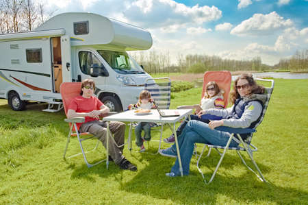 Photo pour Family vacation, RV travel with kids, happy parents with children have fun on holiday trip in motorhome, camper exterior - image libre de droit