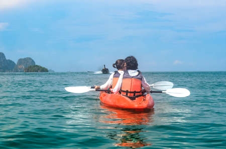 Photo pour Family kayaking, mother and daughter paddling in kayak on tropical sea canoe tour near islands, having fun, active vacation with children in Thailand, Krabi - image libre de droit
