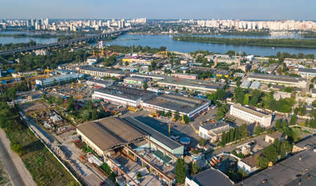 Photo for Aerial top view of industrial park zone from above, factory chimneys and warehouses, industry district in Kiev (Kyiv), Ukraine - Royalty Free Image