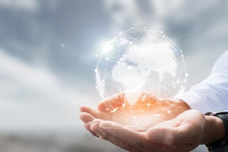 Photo pour Businessman holding in hand with global connection concept. - image libre de droit