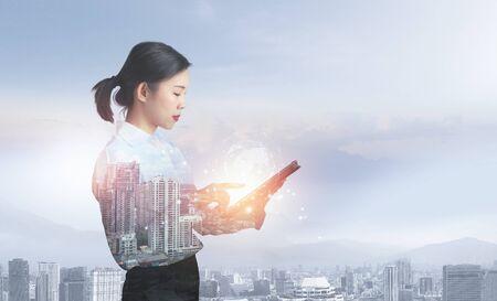 Photo pour Attractive business lady working on tablet. Innovation technology concept - image libre de droit