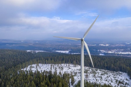 Photo for Windmill energy in forest drone photo - Royalty Free Image