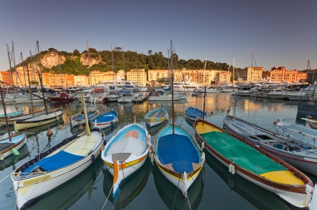 Old classic wooden boats and luxury yachts rest in the old port of Nice , cote azur, France