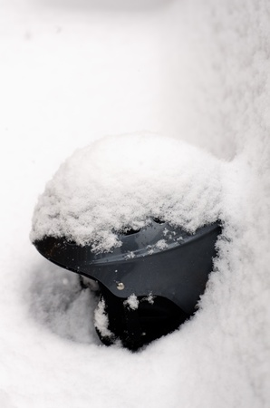 Close up of a ski helmet covered with fresh snow
