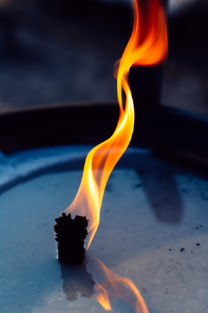 Close up of the flame burning from an Oil lamp in the beach Cannes,France