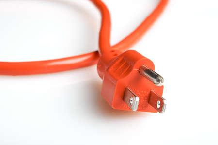 Close up of an orange power plug