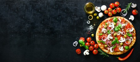 Photo for Food ingredients and spices for cooking mushrooms, tomatoes, cheese, onion, oil, pepper, salt, basil, olive and delicious italian pizza on black concrete background. Copyspace. Top view. Banner - Royalty Free Image