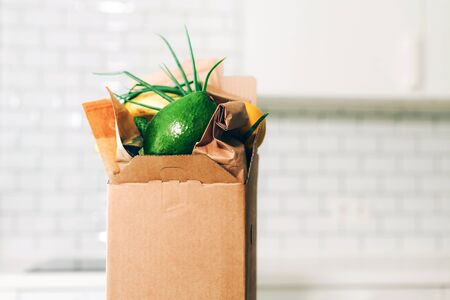 Foto für Food delivery service during coronavirus pandemic. Groceries box on white kitchen background with copy space. Online shopping. Food supplies, donation box, meal box concept. Stay home, stay safe. - Lizenzfreies Bild