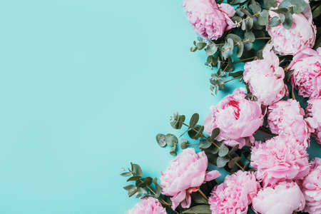 Photo for Floral pattern, frame made of pink peonies, eucalyptus flowers on pastel blue background. Flat lay, top view. Copy space. Wedding, birthday, anniversary bouquet. Valentines, Woman day, Mothers day. - Royalty Free Image
