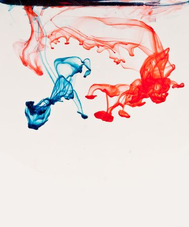 Red and Blue Liquid Through Water