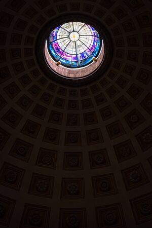 Foto de Monumental stained glass under the dome of a church in Rome, Italy - Imagen libre de derechos