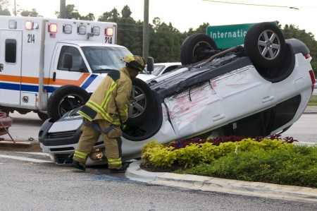Rollover Vehicle Accident at Busy Intersection With Emergency Personnel to Assist