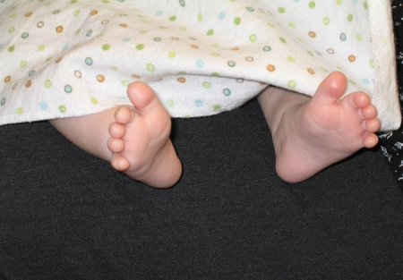The happy feet of a breast-feeding baby express the pleasure she feels