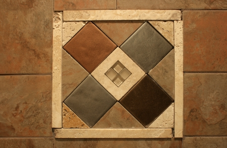 An inlaid decorative wall tile graces the wall in an abstract pattern